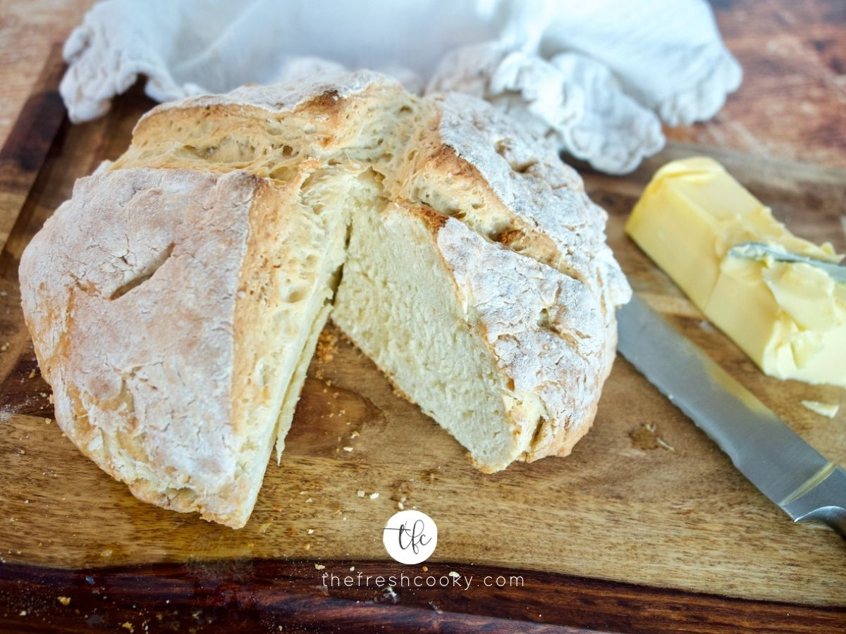 Facebook image for 4 ingredient Irish soda bread with wedge removed and irish butter on side.