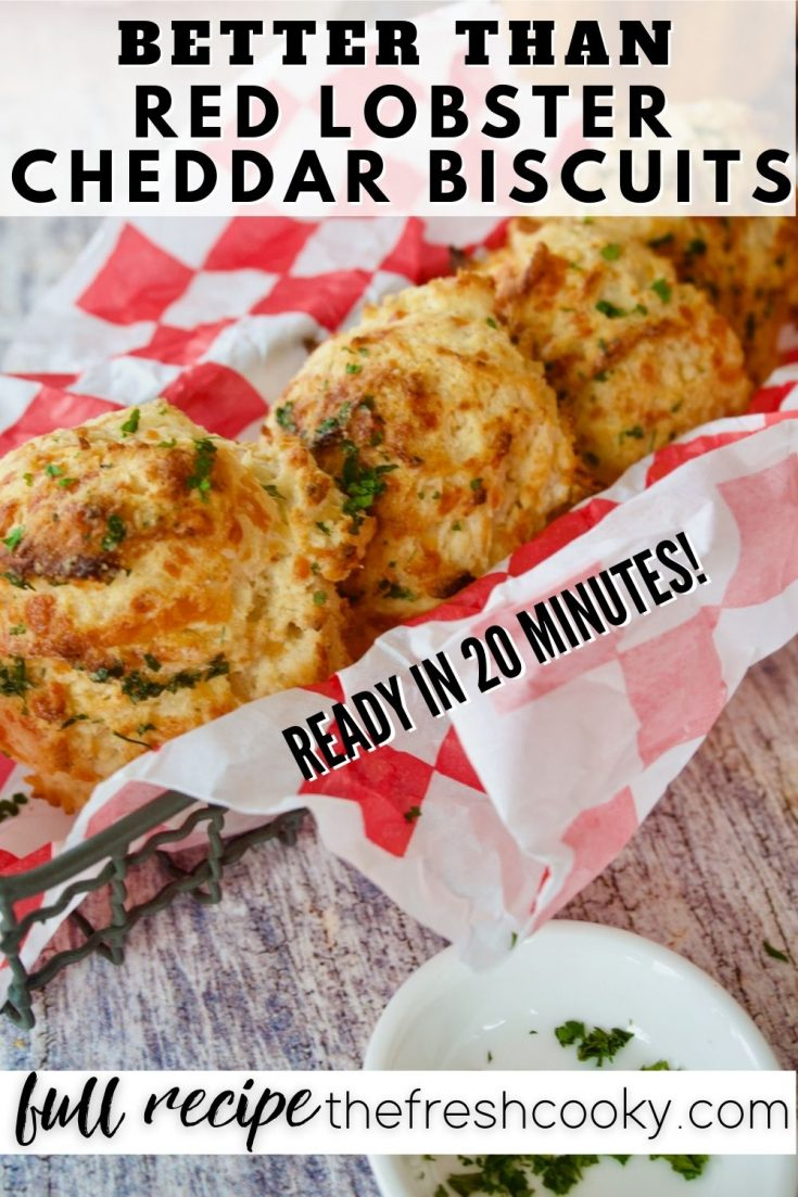 Pin for Better than Red Lobster Cheddar Biscuits with basket of tender, hot biscuits.