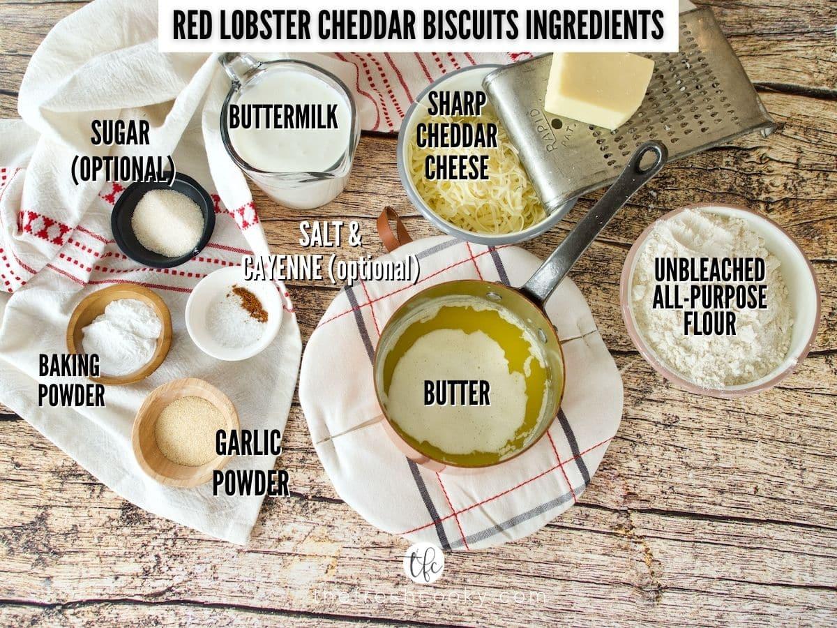 ingredient shot for red lobster cheddar biscuits, L-R Buttermilk, sharp cheddar cheese, flour, melted butter, garlic powder, baking powder, salt, cayenne, sugar.