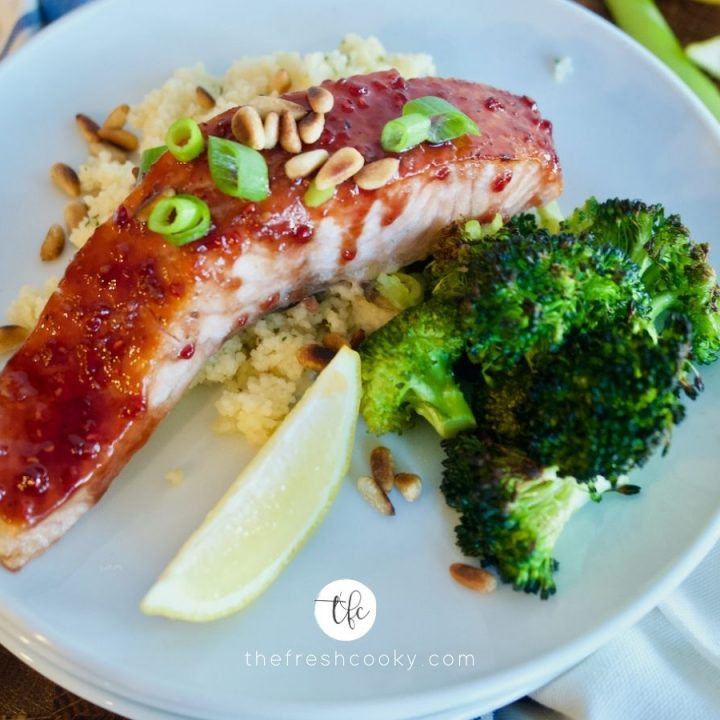 Facebook image of raspberry glazed salmon fillet sitting on top of couscous with roasted broccoli.