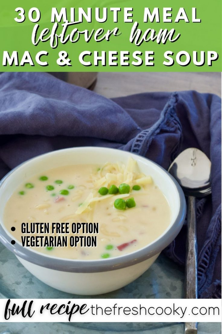 Pinterest image for 30 Minute Meal Ham Mac & Cheese Soup with image of bowl of soup with spoon on the side with blue napkin.