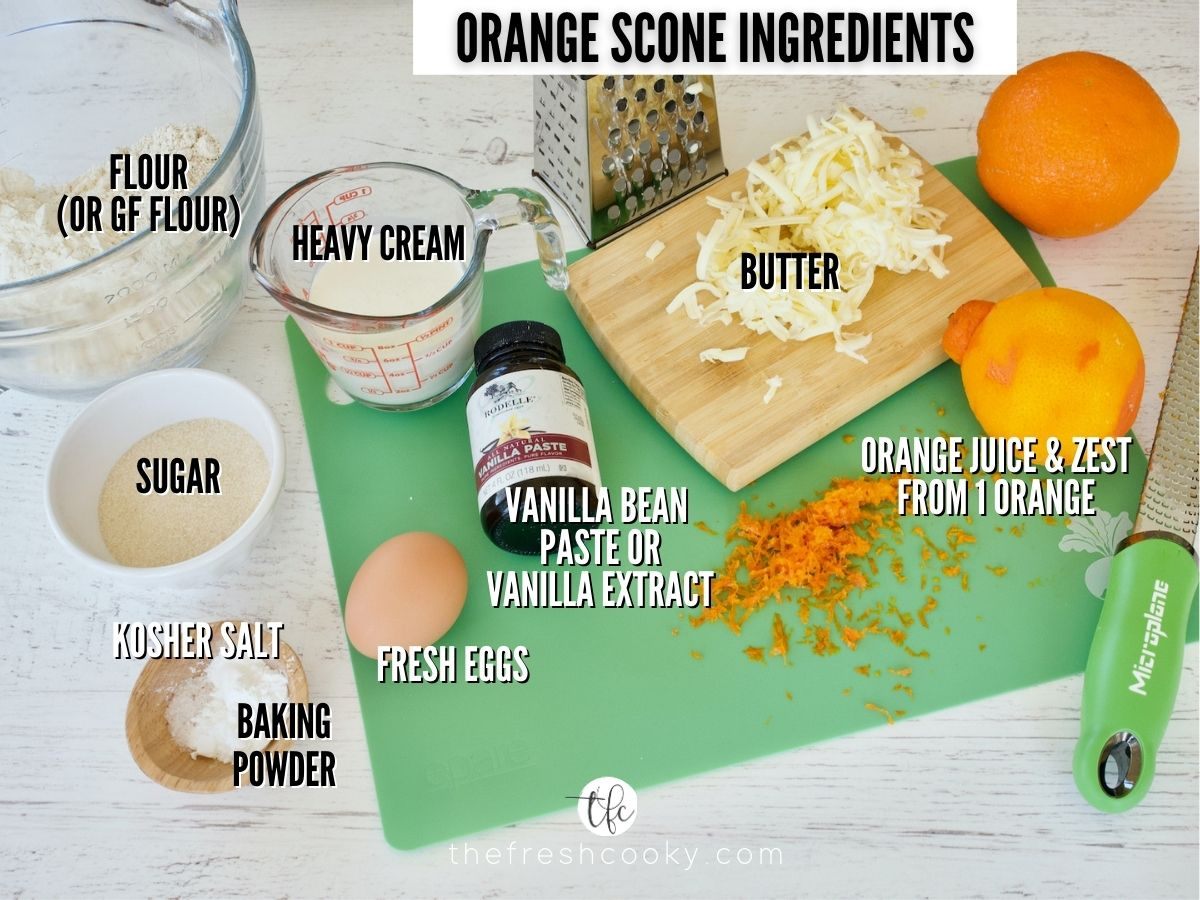 Panera Orange Scones recipe ingredients L-R all purpose flour, heavy cream, grated butter, oranges for zest and juice, vanilla bean paste, egg, baking powder, salt, sugar.