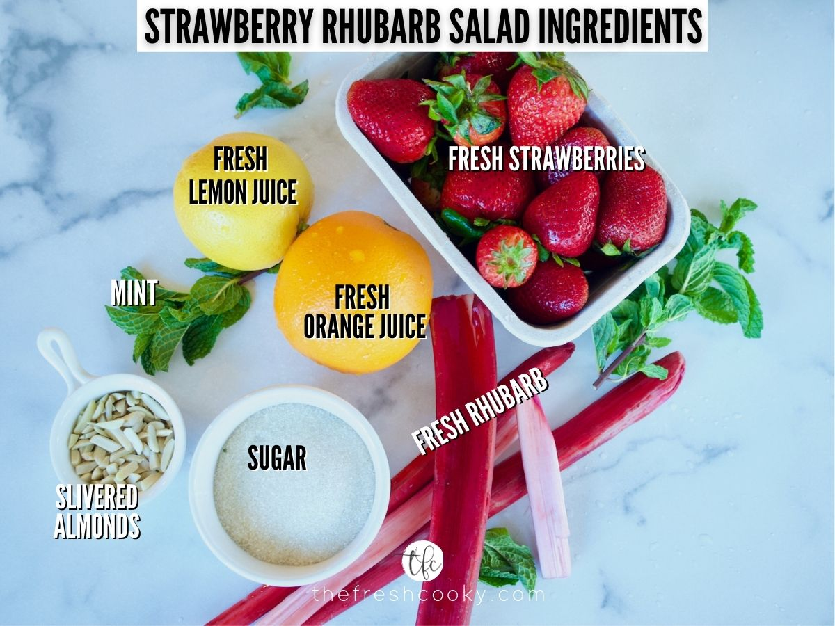 Strawberry Rhubarb Salad Ingredient Shot L-R Lemon, Strawberries, Mint, Rhubarb stalks, Sugar, Almonds and Orange.