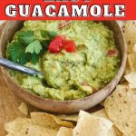Pin for 5 minute Easy Guacamole with wooden bowl filled with super simple guacamole and chips around the bowl.