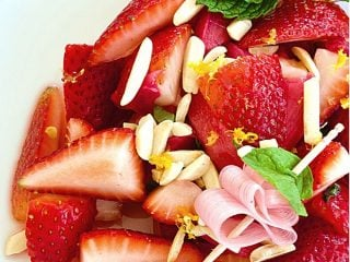 Pinterest image for Strawberry Rhubarb Salad on white plate with mint and rhubarb ribbon.