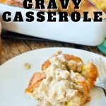the best Biscuits and Gravy Casserole with image of slice of casserole on a dish with a spoonful of sausage gravy running over the top.