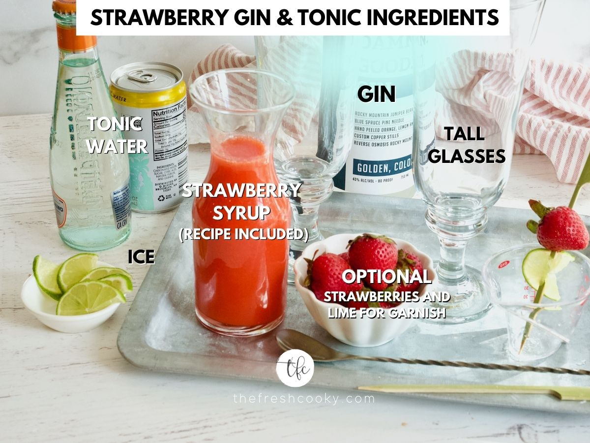 Ingredients for Strawberry Gin Cocktail L-R Tonic Water, Strawberry Syrup, Gin, Ice, Fresh Strawberries, wedge of lime.