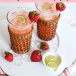 Pin for Pink Gin and Tonic, Strawberry Gin and Tonics in tall pretty glasses garnished with lime and strawberries.