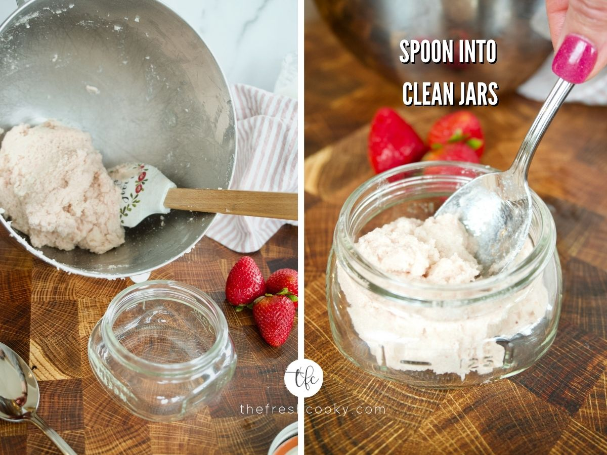Spooning strawberry sugar scrub into clean jars for gifting.