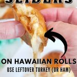 Hawaiian Roll Turkey Chicken Sliders with hands holding a gooey, melty cheese slider.