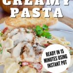 Pin for easy creamy pastas with sun dried tomatoes, on white plate with garlic bread in background and green salad.