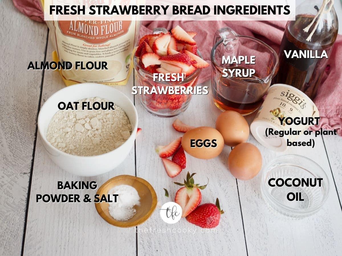 strawberry quick bread ingredients almond flour, fresh strawberries, maple syrup, vanilla, yogurt, eggs, baking soda, salt and oat flour.