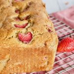 Pin for strawberry bread with image of loaf of fresh baked strawberry bread on wire cooling rack.