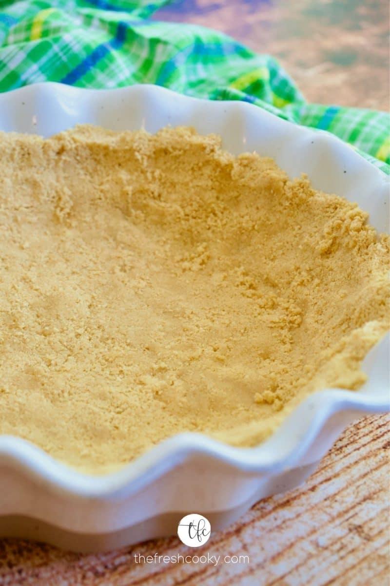Oreo Cookie Crust in a white ruffled edge pie plate.