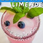 Blueberry Limeade Drink with top down shot of sugar rimmed glass filled with blueberry limeade.