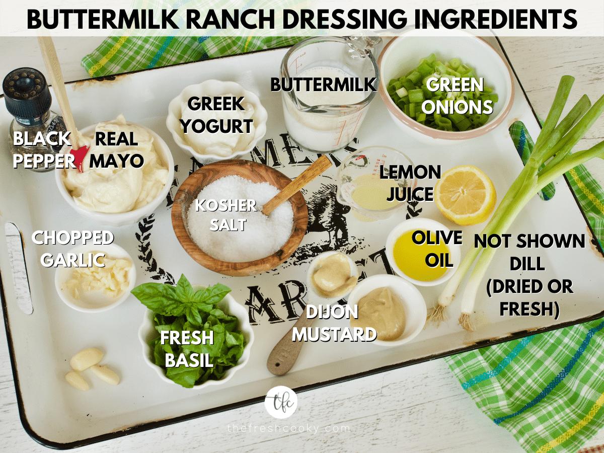 Ingredient shot labeled for Buttermilk Ranch Dressing L-R Black pepper, mayo, Greek yogurt, buttermilk, chopped green onions, olive oil, lemon juice, dijon mustard, kosher salt, basil leaves, garlic and not shown is dill leaves.