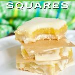 Image of three lemon squares, topped on each other with bite taken out of the top.