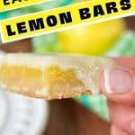 East Best Lemon Bars or Lemon Squares, with hand holding a gooey lemon square.