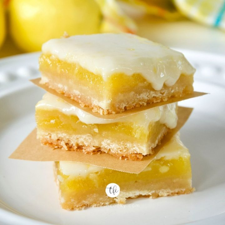 Easy Old Fashioned Lemon Squares square image, with three lemon bars stacked on top of one another.