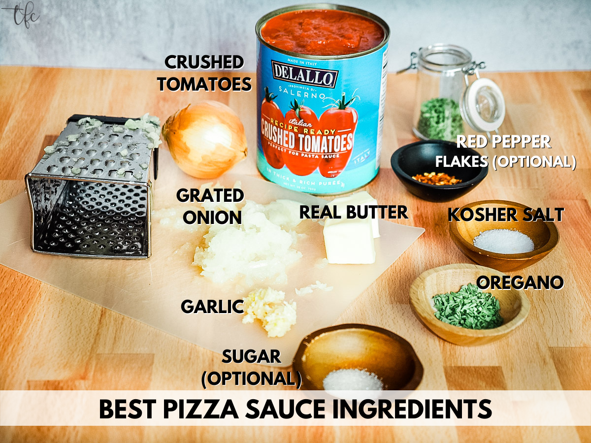 Ingredients for best pizza sauce L-R grated onion, crushed canned tomatoes, oregano, red pepper flakes, salt, sugar, butter and garlic.