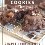 Pin for Triple Chocolate Cookies with chewy fudgy cookies on cooling rack broken in half.