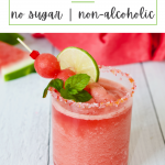 Watermelon slushie in a glass decorated with sugar with a red napkin behind.