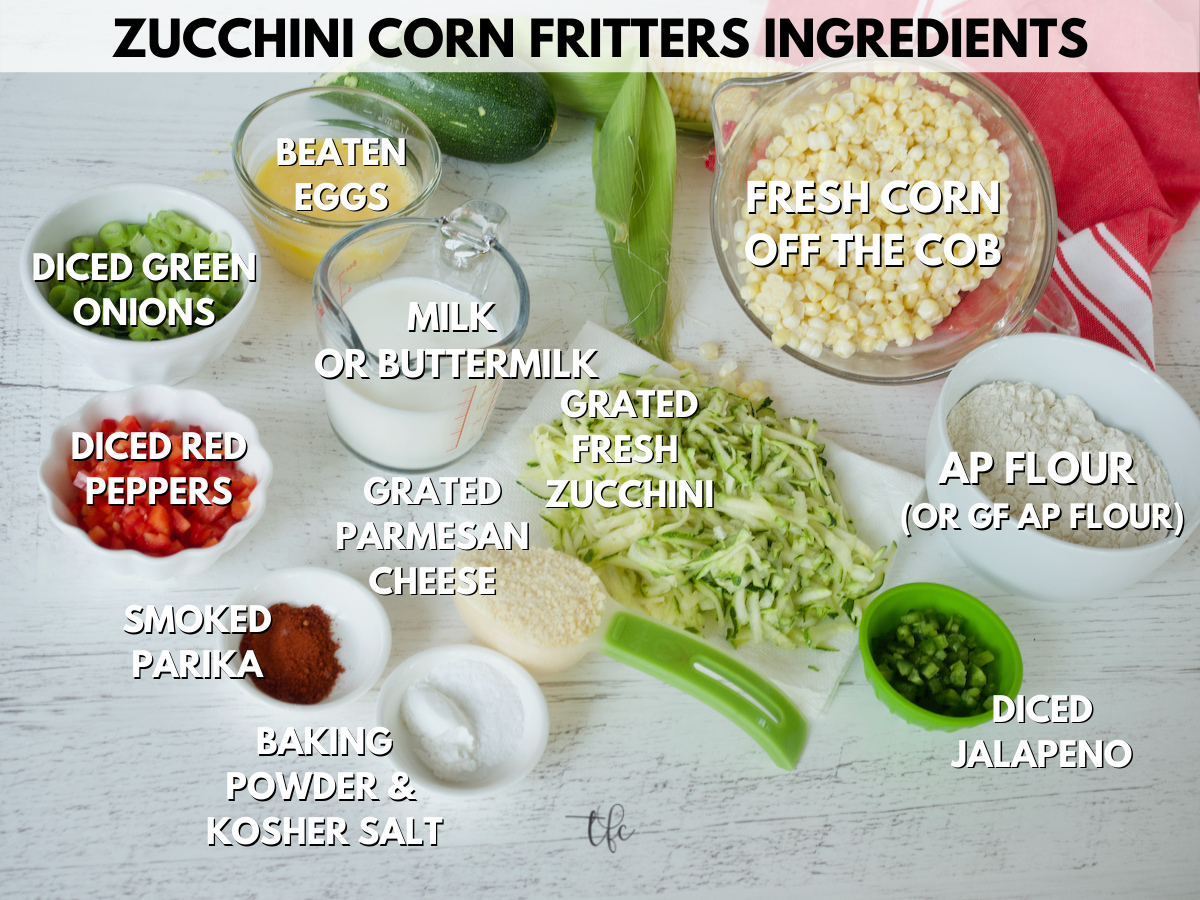 Ingredient shot for Zucchini COrn Fritters L-R chopped green onion, eggs, buttermilk, fresh corn, flour, jalapeno, grated zucchini, parmesan cheese, baking powder, salt, smoked paprika and red pepper.
