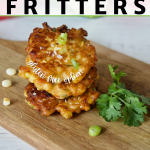 Pin for Zucchini Corn Fritters, healthier and with gluten free option, 3 stacked fritters on a cutting board with fresh cilantro.
