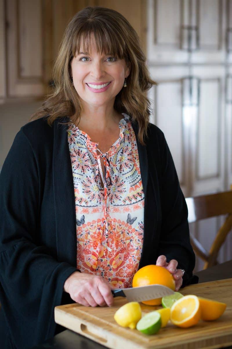 "Head shot, Kathleen ""The Fresh Cooky"" cutting fresh citrus."