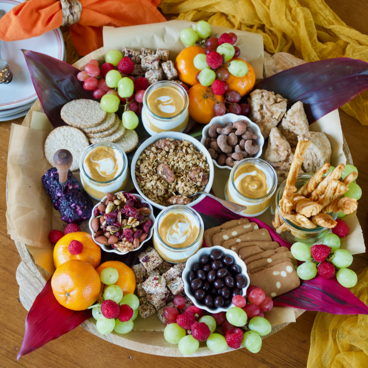 Fall Charcuterie Breakfast Grazing board top down shot with nibbles, yogurt, crackers and fruit Square image.