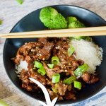 Pin for Mongolian Beef recipe, with image of bowl filled with rice, steamed broccoli and mongolian beef with chopsticks and scallions sitting nearby.