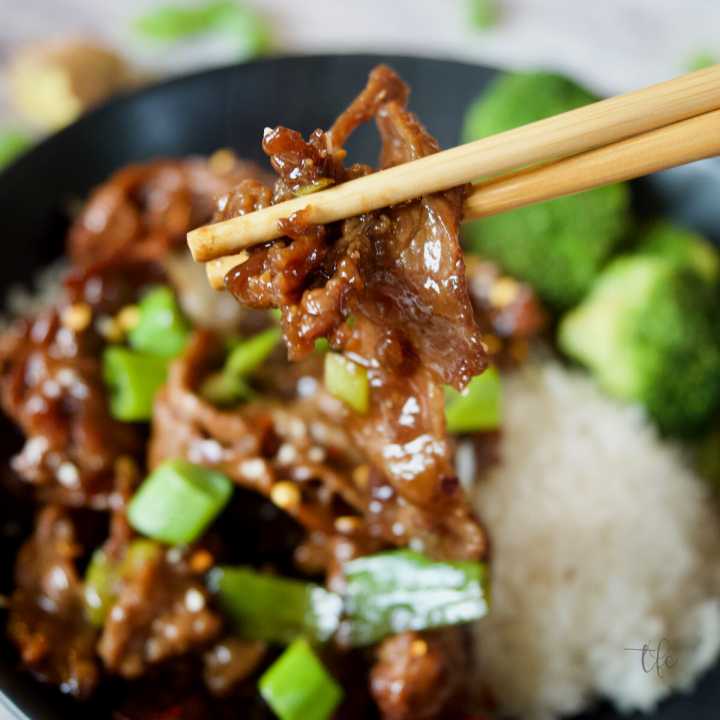 Mongolian Beef Recipe chopsticks grabbing a tender slice of beef.