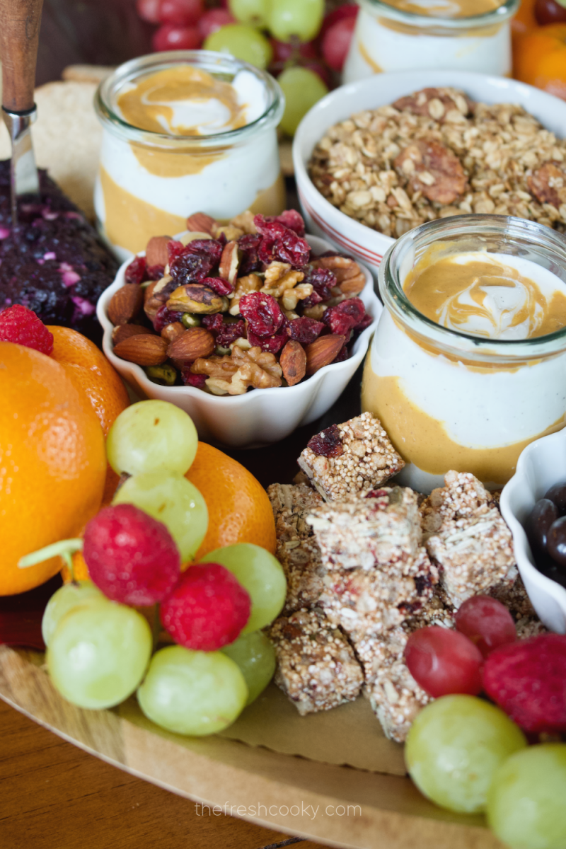 Image of pumpkin yogurt on a fall breakfast charcuterie board.