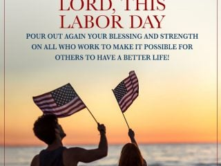 Labor Day prayer with an adult and child waving American flags watching the sunset at the beach.