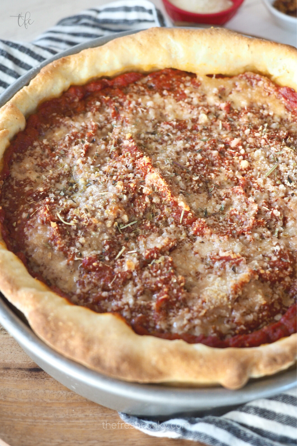 Chicago-Style Deep Dish Pizza in pan after baking with golden crust.