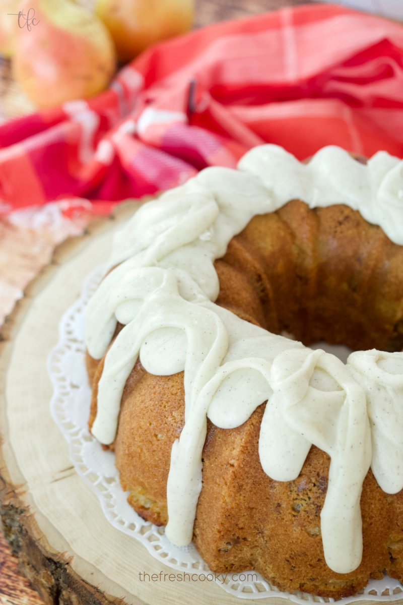 Image of glazed pear bundt cake with fingers of glaze dripping down the sides.