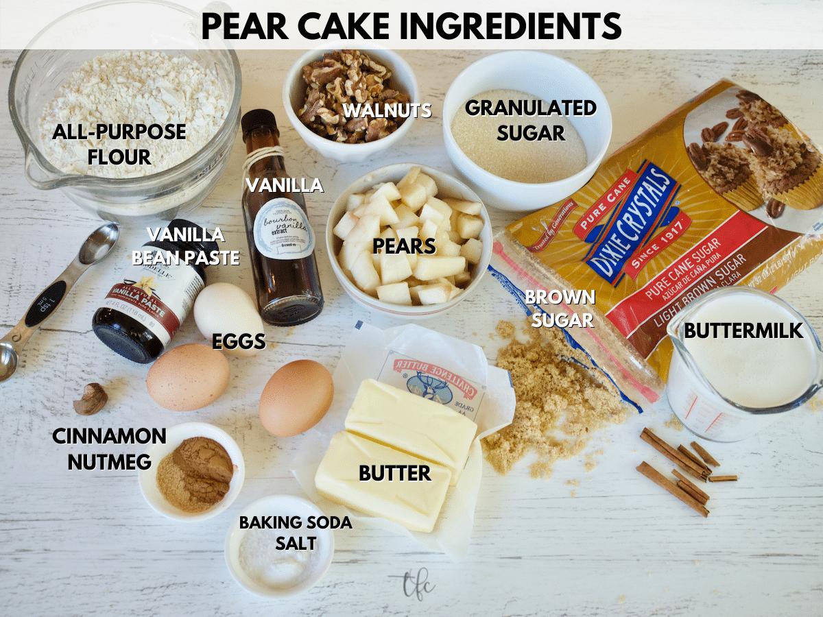 Pear Cake Ingredient shot from L-R all purpose flour, walnuts, granulated sugar, brown sugar, buttermilk, butter, baking soda, salt, cinnamon, nutmeg, vanilla bean paste, eggs, vanilla extract and pears.