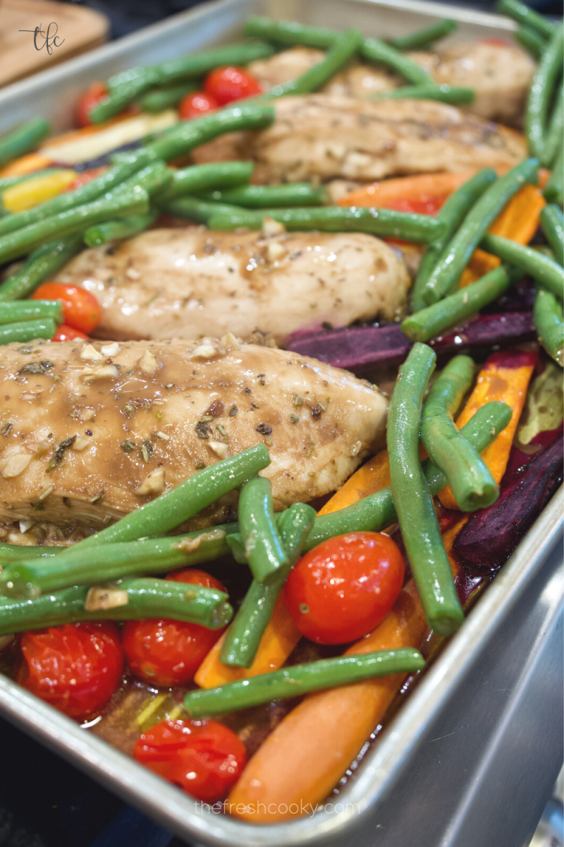 Add green beans to sheet pan chicken during last 15 minutes of roasting balsamic chicken sheet pan dinner.