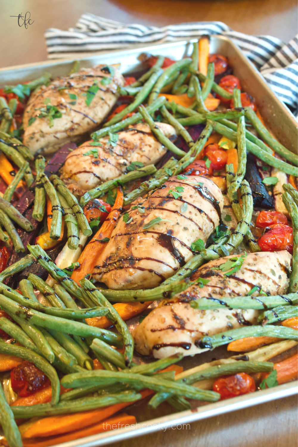 Easy Balsamic Maple Chicken Sheet pan dinner with carrots and green beans and a balsamic glaze drizzle.
