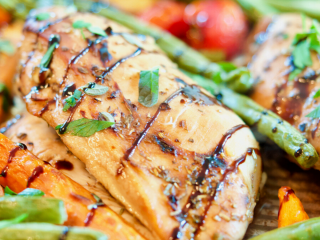 Balsamic Maple Chicken and Veggie Sheet Pan dinner, close up with green beans, carrots and tomatoes.